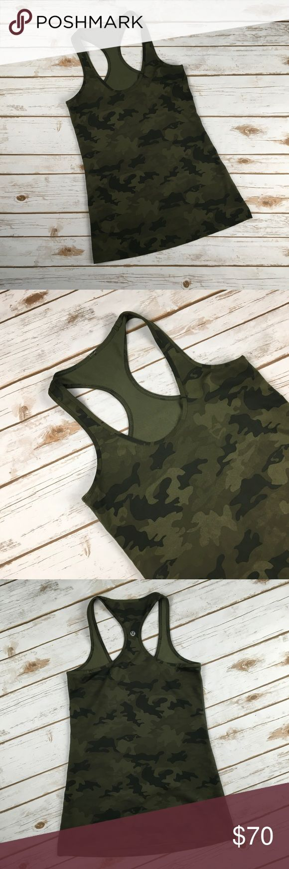 "Lululemon Camo Tank Racerback Cool CRB Green 6-8 Lululemon Camo Tank Racerback Cool CRB Green 6-8 Beautiful and hard to find lululemon camo racerback tank.  Size tag was removed but it measures like a 6-8.  Please measure a similar lulu tank you own to confirm sizing works for you!  Measured flat unstretched. Bust - 14.5"" Length from top of strap to hem - 28"" No holes, stains, tears. See photos. Ask any questions before purchasing lululemon athletica Tops Tank Tops"