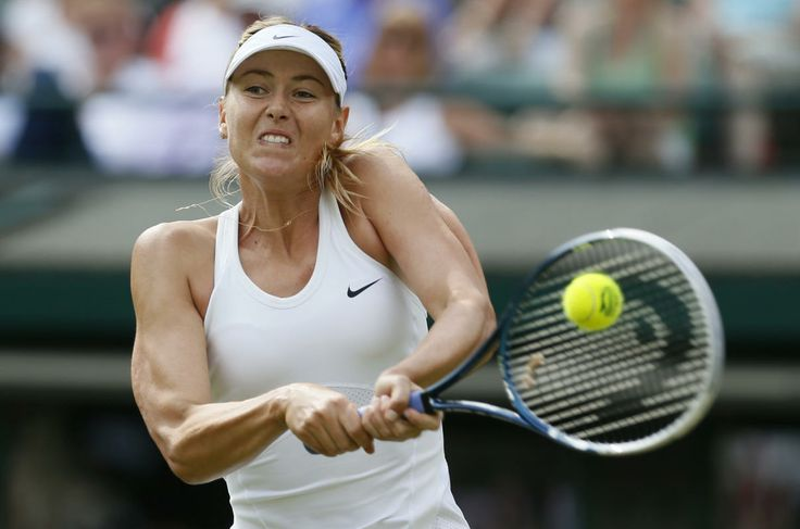 Maria Sharapova of Russia hits a return to Samantha Murray of Britain in their women's singles tennis match at the Wimbledon Tennis Championships, in London June 24, 2014.