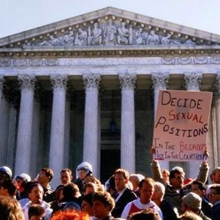 """""""DECIDE SEXUAL POSITIONS IN THE BEDROOM NOT IN THE COURTROOM,"""" demonstrators protest Bowers v. Hardwick (which upheld as constitutional state anti-sodomy laws) during events surrounding the Second National March on Washington for Lesbian and Gay Rights, Supreme Court, Washington, D.C., October 13, 1987. Photo by Susan Steinkamp, © Corbis"""
