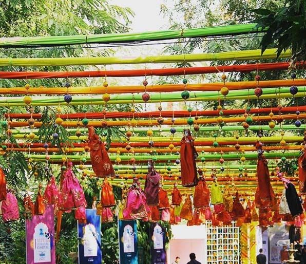 Multi coloured puppets, screechy green parrots, harlequin kites lazing in a deep blue sky. At the Jaipur Literary Festival.