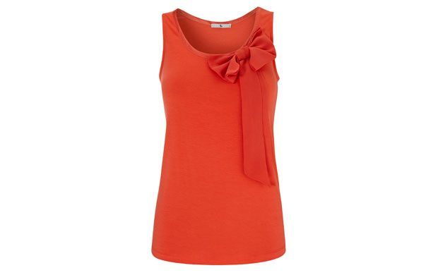 "Bow Tank Top. ""Bring a touch of glamour to your style staples this summer; a bow adds femininity to this top's simple shape."""