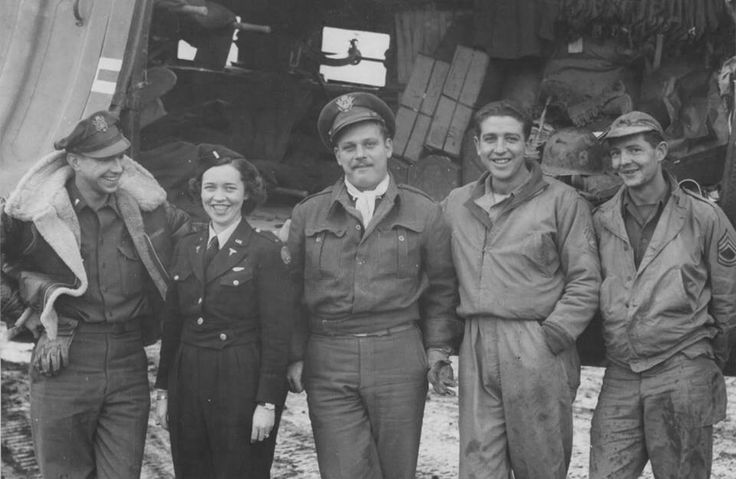 Sicily - The crew of a medical air evacuation flight pose for their picture alongside their plane. Left to right: pilot, 1st Lt. James M. Hayes, Jr.; flight nurse, 2nd Lt. Katye Swope (802nd Medical Air Evacuation Transport Squadron); co-pilot, 1st Lt. C. M. Worley; crew chief, T/Sgt. M. C. Jacobsen; and radio operator, T/Sgt. Leo Mortell ~
