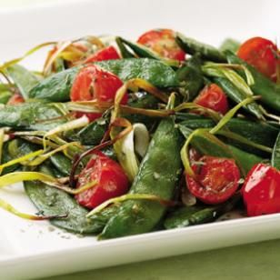 Italian Roasted Snap Peas  Serve this Italian-inspired combination of sweet snap peas, leeks and tomatoes with roast chicken or garlic-rubbed grilled steaks.