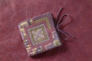 Lovely little embroidered needle book made to look like a tiny quilt.