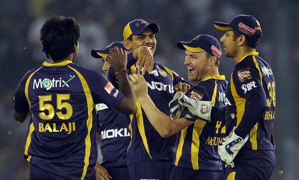 Kolkata Knight Riders wicket keeper Manvinder Bisla (R) and Brendon McCullum (2R) celebrate the run out of Kings XI Punjab batsman David Hussey with teammates during the the IPL Twenty20 cricket match between Kings XI Punjab and Kolkata Knight Riders at PCA Stadium in Mohali on April 18, 2012.