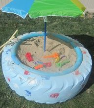 Make a sandbox with a tire! I only ever played in a tractor tire sandbox..but no one painted or stuck an umbrella in it for us..lol. Tractor tires made great sandboxes except you had to watch out for the snakes that liked to curl up inside the rim of the tire.