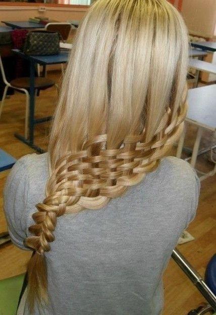 Make three ponytails, braid, then twist into three buns and pin.