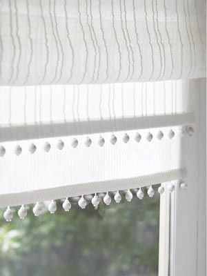 Osborne and Little sheer blinds. Pom-poms are cute!