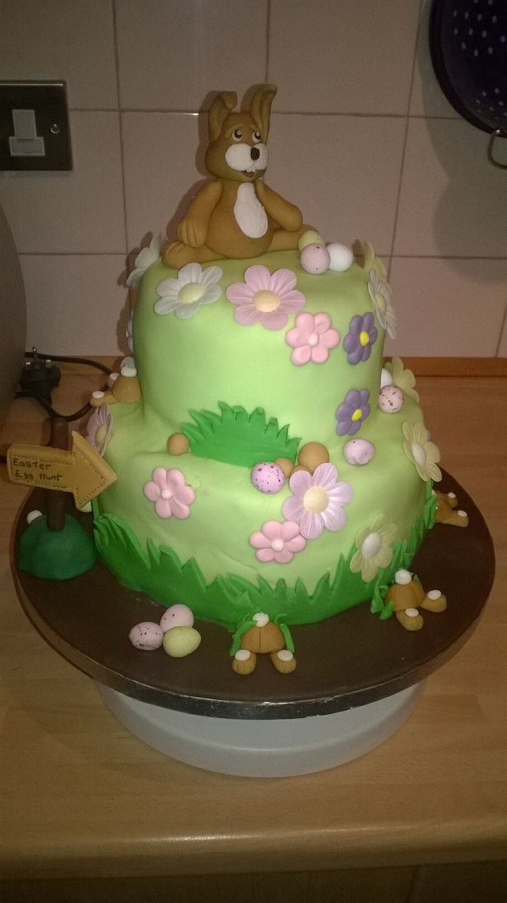 Easter cake with hidden mini eggs inside the top tier