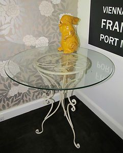 Very pretty butterfly table. Ornate and stylish!