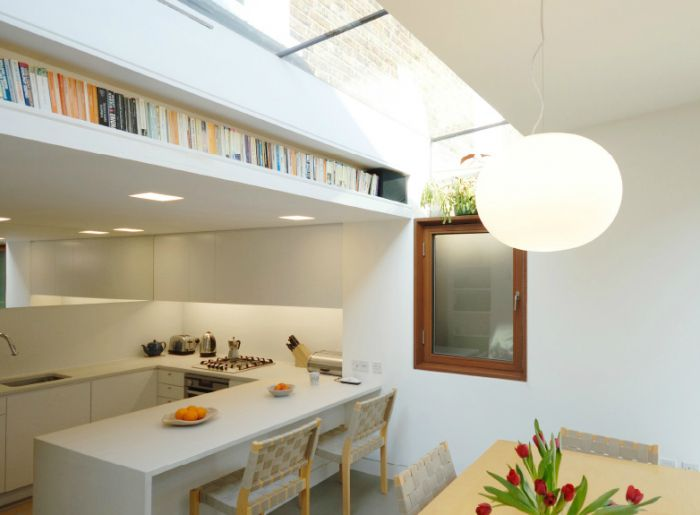 creative storage solution in kitchen with built in book shelf by Levitate Architecture and Design Studio