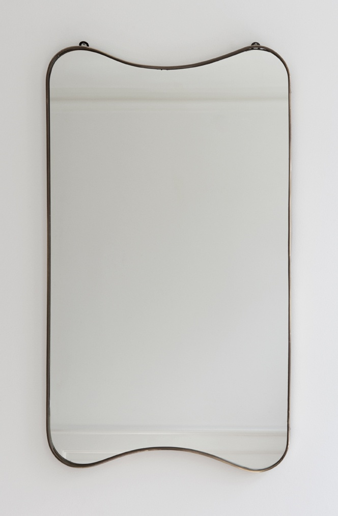 1950s, Italy. Vintage mirror with curved brass frame.