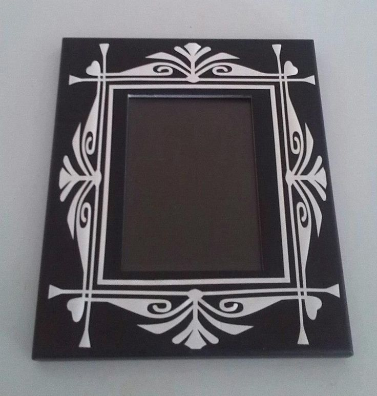 Found an old wooden photo frame, gave it a paint and added a vinyl border.
