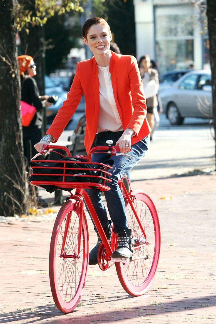 Coco Rocha on a red bike from Harper's Bazaar.