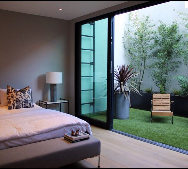 Great idea to use artificial grass for this bedroom patio...