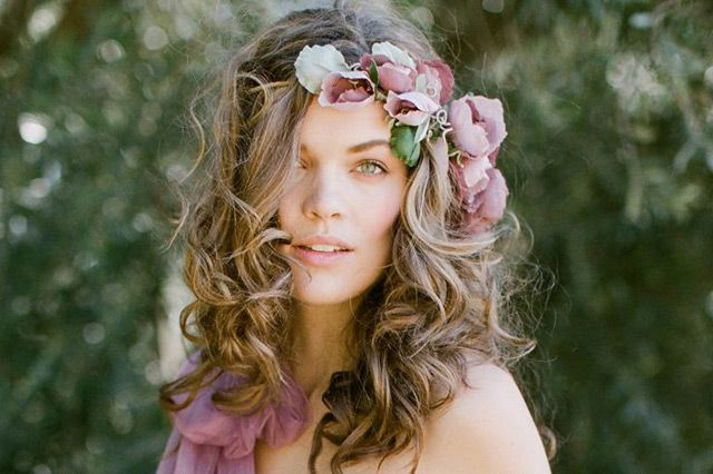 Instead of having your bridesmaids carry flowers, have them wear them in their hair - Mon Cheri Bridals
