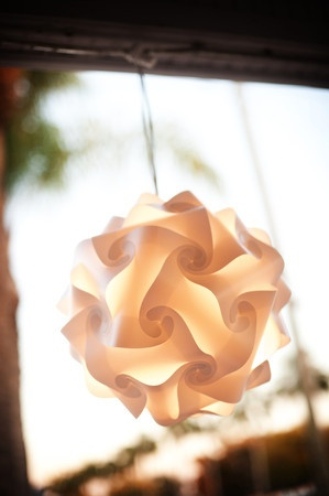 White puzzle light hanging outside