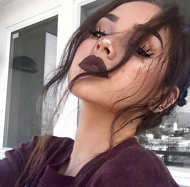 Dark lipstick & big lashes