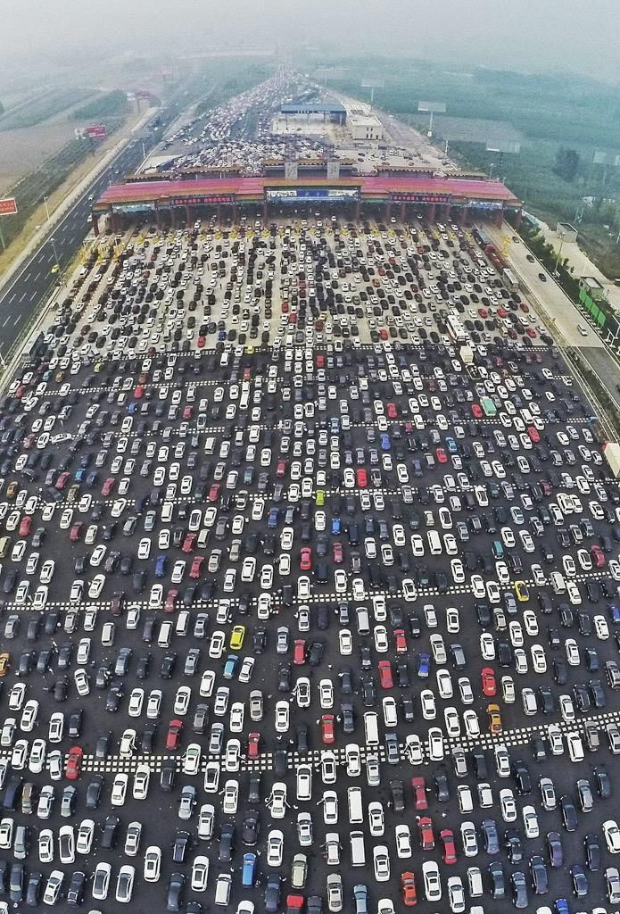Beijing traffic jam.  What happened to all those bicycles?