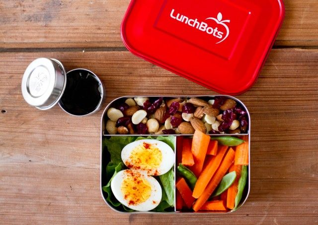 Hard boiled egg, carrots, snow peas, and homemade trail mix (combine different nuts and dried fruit) in the LunchBots Trio. For larger appetites, add another hard boiled egg. There is plenty of room. Salad dressing in the LunchBots Dip.