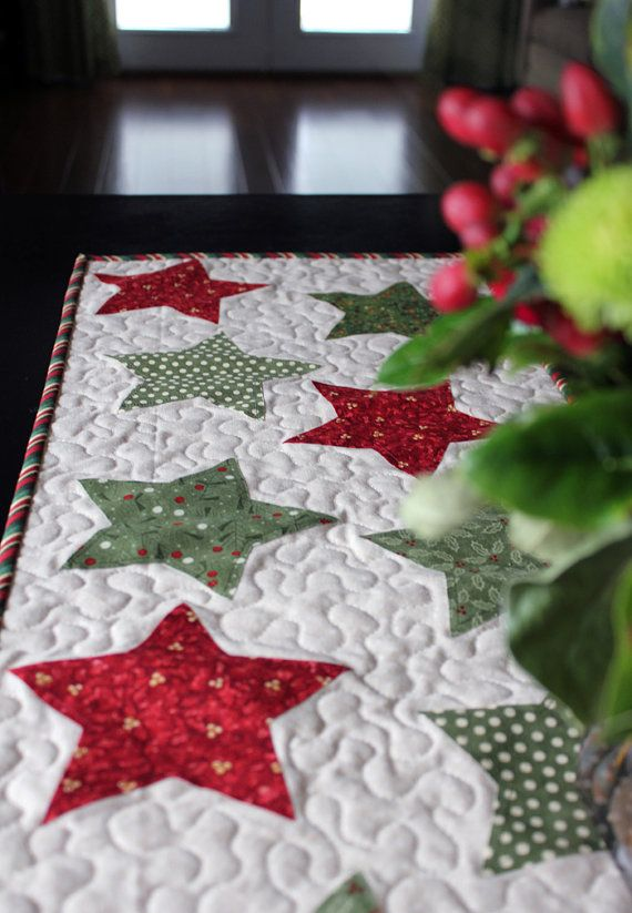 Quilted Stars Christmas Table Runner from aBrightCorner on Etsy. I love the barber pole border.