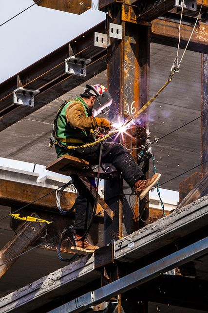 Iron Worker Welding- this iron worker is a proletariat who does manual labor…