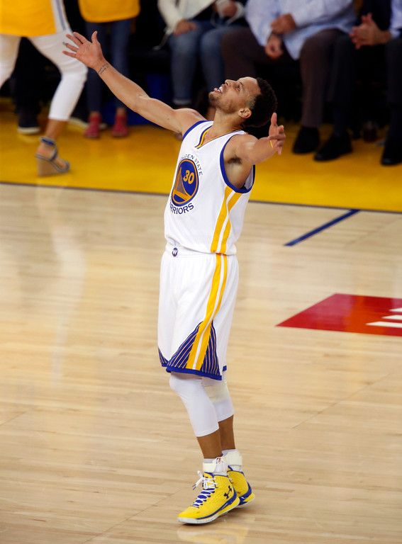 . Golden State Warriors\' Stephen Curry (30) celebrates in the first quarter of Game 5 of the NBA Western Conference semifinals against the Memphis Grizzlies at Oracle Arena in Oakland, Calif., on Wednesday, May 13, 2015. (Nhat V. Meyer/Bay Area News Group)
