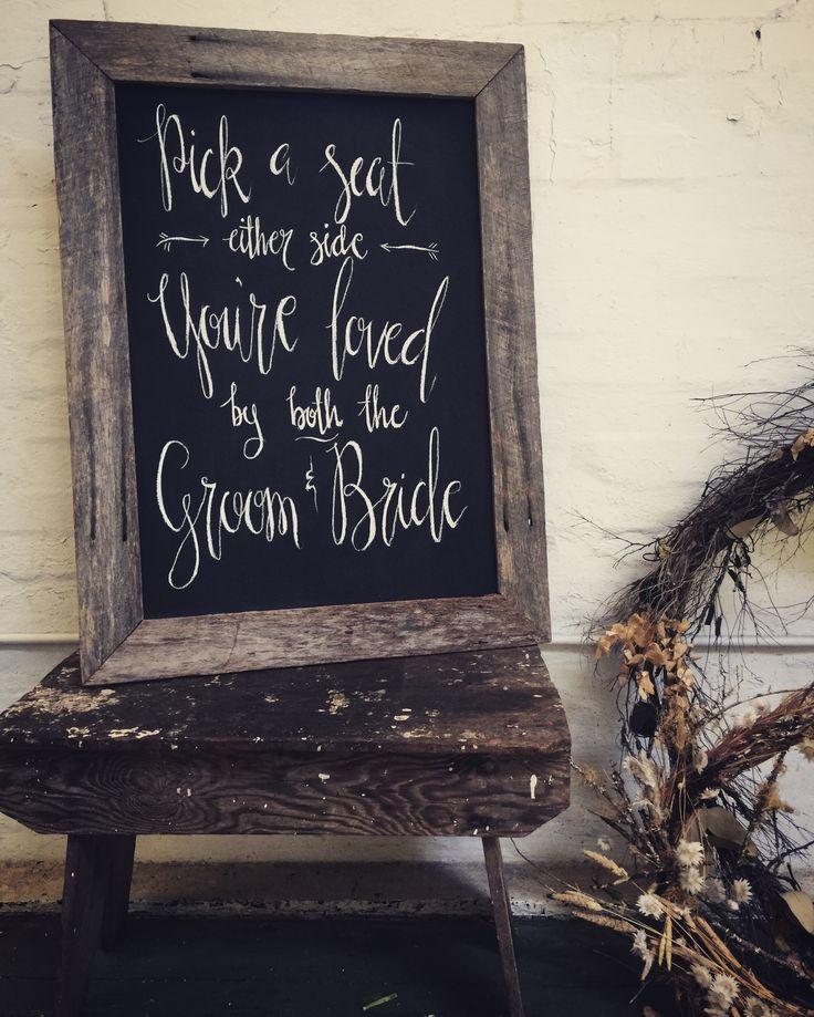 Hand writen chalk signs - pick a seat not a side