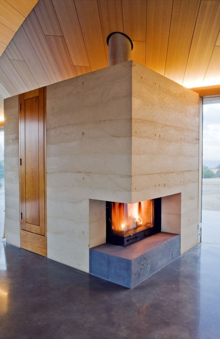 Rammed earth wall and wood. Architect James Stockwell has designed the Croft House near Inverloch, Australia.