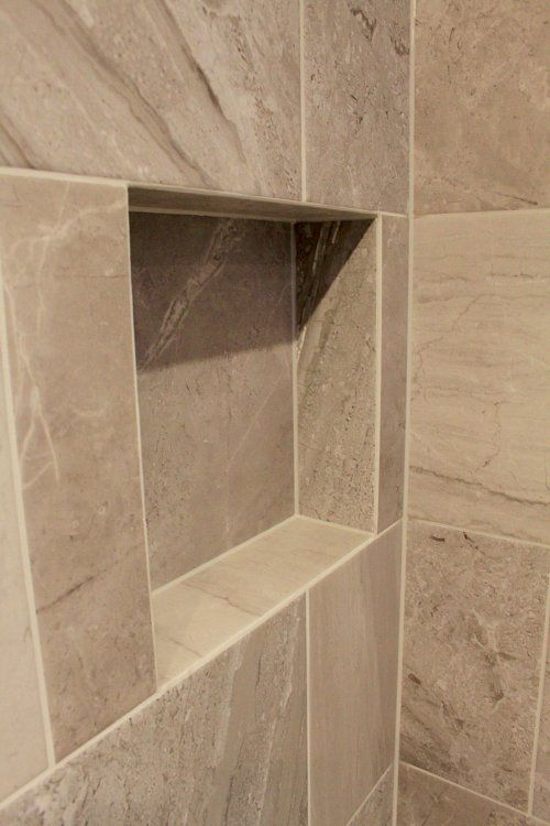 Mitred tile edges in a recessed shelf. Always a better ...