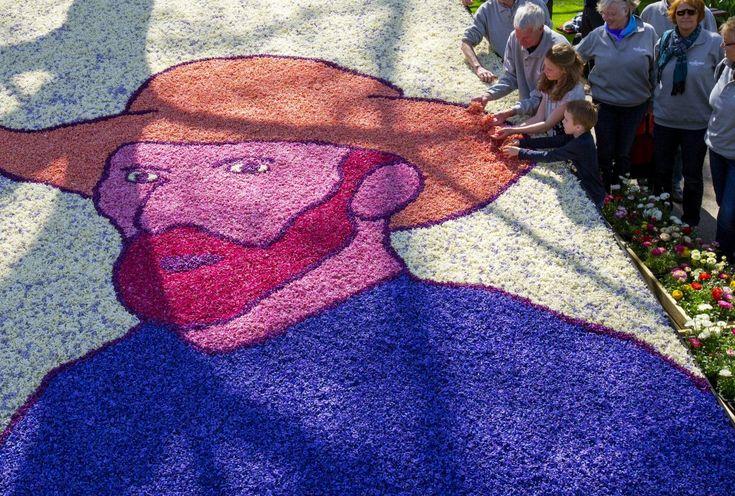 Children place the last petals on a portrait of painter Vincent Van Gogh at the Keukenhof park. (Photo: Yves Herman/Reuters)