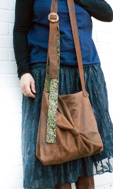 Ultra huge purse with an ultra long strap, and an ultra-unique look :)