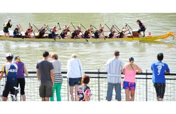 Spectators watch as the Dragon Blades race past at the Dragon Boat Festival in Edmonton on Sunday, Aug. 18, 2013.