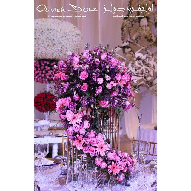 The flower arrangement was made using a big bird cage, full of flower and very trendy. #uae  #dubai #wedding #bride #kosha #planner #theme #royal #royalwedding #doha #qatar #Weddingplanner  #dubaiwedding  #vipwedding #luxurywedding #olivierdolzwedding #flower #paris #flowerarrangement #florist #centerpiece #olivierdolz #mydubai