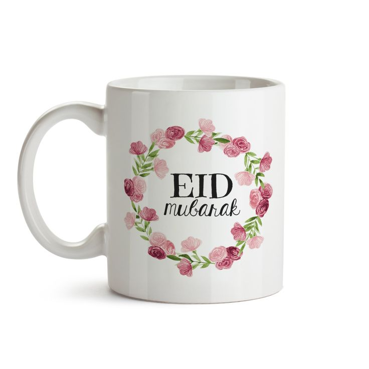 """Eid Gifts- Eid Mug - Eid Mubarak - Eid Decor - Ramadan Mubarak - Ramadan Gifts - Islamic gifts - Islamic Mug - Arabic Gifts - Pink/Rose Floral Mug Design. This simple modern mug says """"Eid Mubarak"""" on the front with a beautiful floral design. On the back it says in Arabic """" Eid Mubarak, Kul 3am wentom bkheir"""" (May you have a blessed Eid, every year). It's perfect for those coffee/tea/chai addicts in your life! This mug can be easily gifted to anyone and everyone. Make someone's Eid a bit…"""