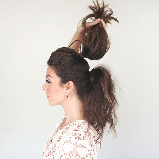 Transform a ponytail from limp and lifeless to full and fabulous in seconds. Split hair into two equal pieces as shown and pull into top and bottom ponytails. Fluff the top pony over the bottom one.