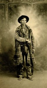 """A portrait of Kit Carson III (son of Willliam Carson and grandson of Kit Carson) in a coat similar to the """"Kit Carson coat"""", circa 1927. Note that this coat was actually owned by Tom Tobin, Carson III's grandfather on his mother's side. Scan number: 10053237."""