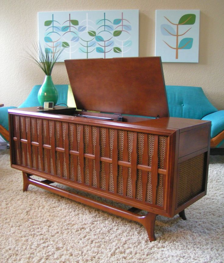 This is a vintage mid century modern Ward's Airline Solid State AM/FM/ Phonograph console with AUX jacks.