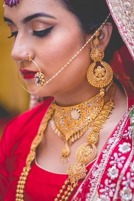 Indian Wedding Jewelry - Traditional Bridal Choker, Gold Raani Haar and Pearl String Nose Ring | WedMeGood #wedmegood #bridal #jewelry #wedding #nosering