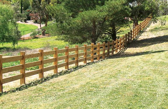 Post and rail fence constructed with cypress pine