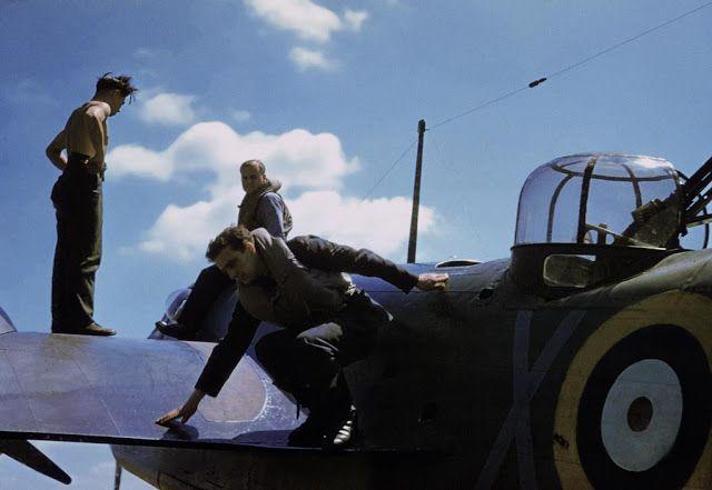 RAF Watton. The crew of a 21Sqn Bristol Blenheim dismount their aircraft photo by Robert Cappa