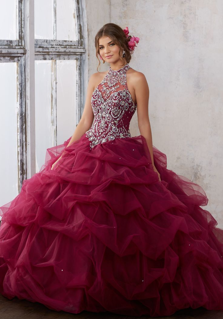 Morilee Quinceanera Dresses  STYLE NUMBER: 89122 Jeweled Beading on a Ruched Tulle Ballgown  Tulle Quinceañera Dress Featuring a Gorgeous Jewel Beaded Bodice and High Halter Neckline. Open Keyhole Corset Back. Matching Stole Included. Colors Available: Black Cherry, Aqua, Cobalt, White.