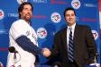 """New Toronto ace R.A. Dickey said Tuesday he's thrilled to join a team that's """"all in"""" to win the World Series and thankful the New York Mets did not meet his contract demands. The Blue Jays formally introduced Dickey at Rogers Centre after acquiring the National League Cy Young Award winner from the Mets last month."""