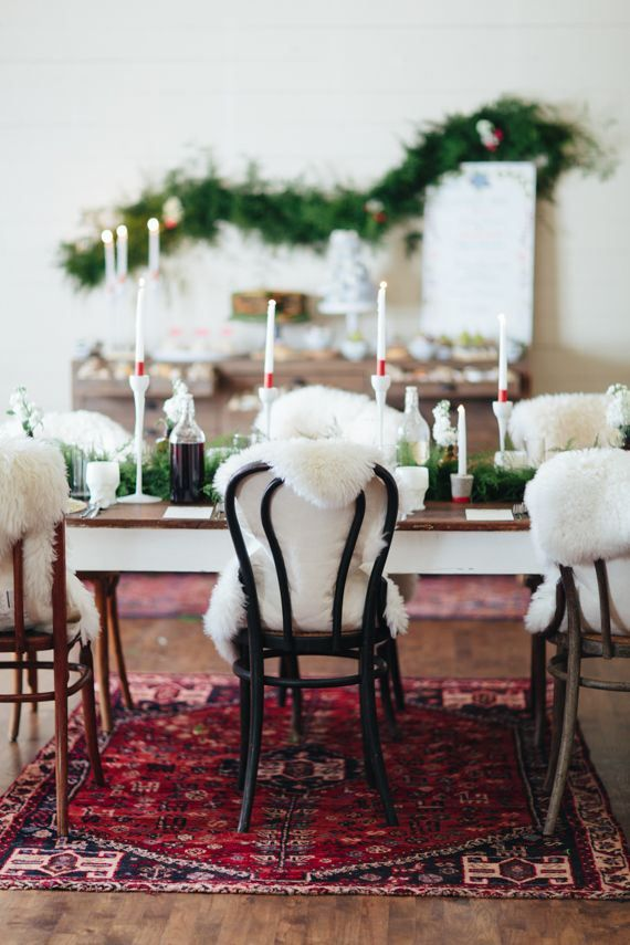 Holiday table faux sheepskin on chairs love dining for Christmas decorating ideas for dining room chairs
