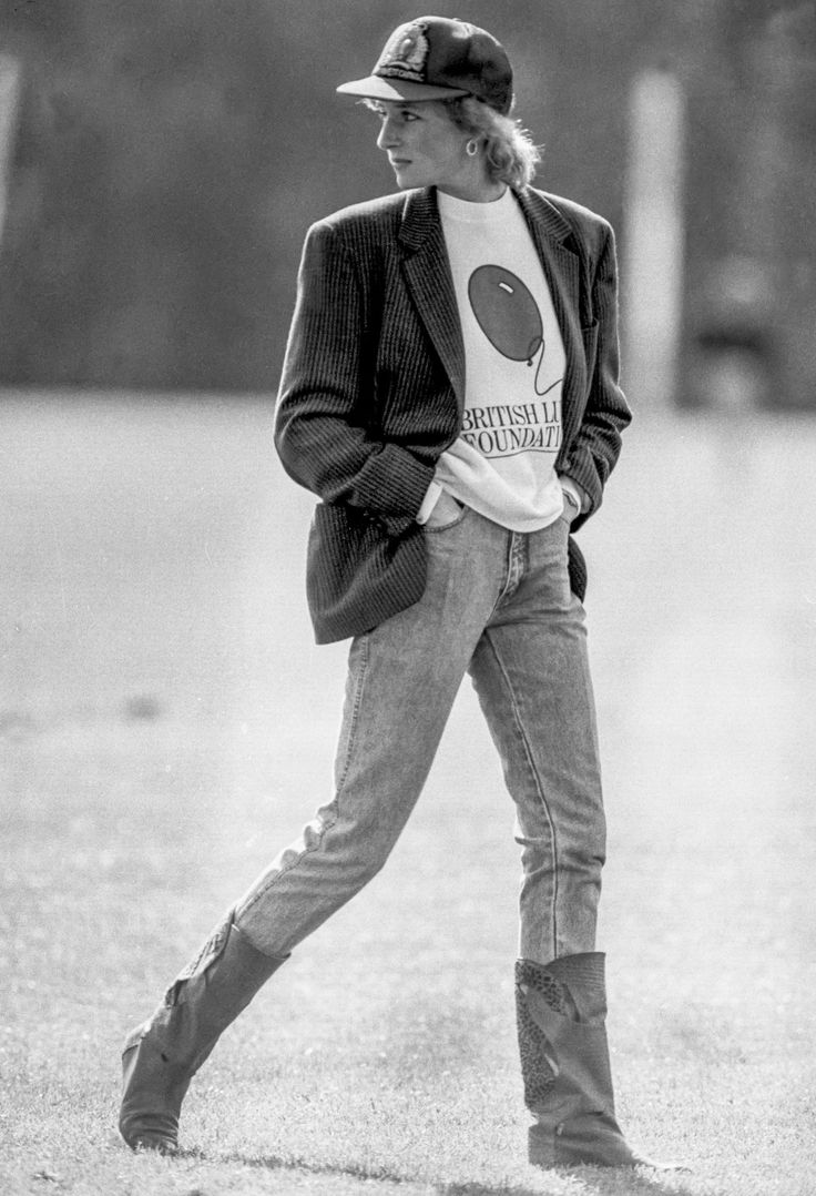 May 1988 Here, Princess Diana watches Prince Charles play polo at Smiths Lawn Windsor in a oversized blazer, T-shirt, jeans, and boots.