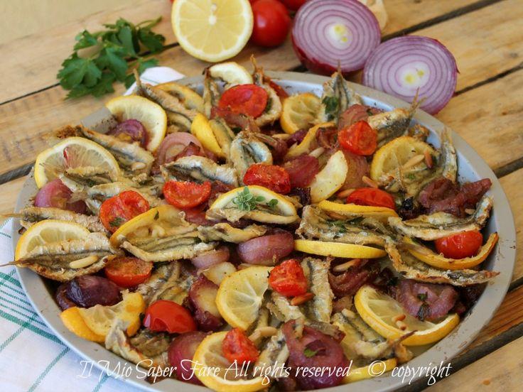 Il tegame di alici al limone con cipolle e pomodorini è un secondo piatto di pesce molto gustoso da servire anche freddo. Alici in tortiera ricetta facile !