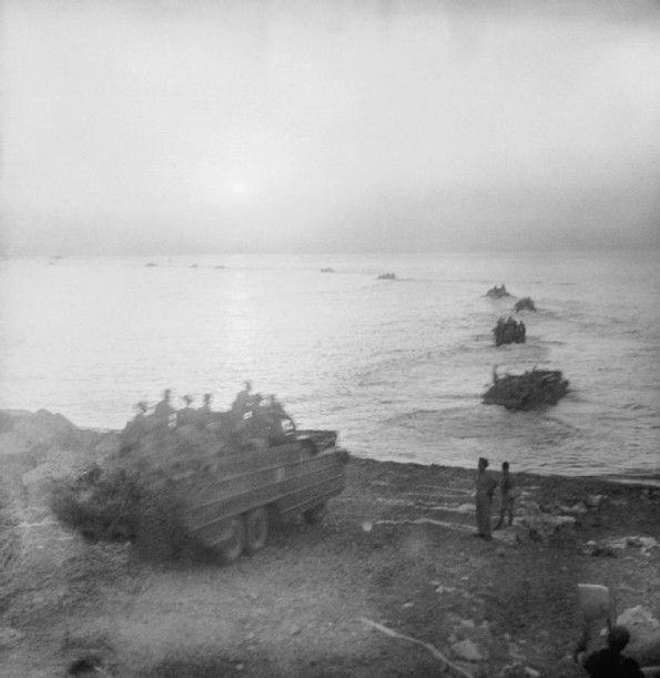 SEP 3 1943 Operation Baytown: the invasion of Italy Amphibious DUKWs loaded with men and equipment, enter the water at Messina in Sicily to cross to the Italian mainland.