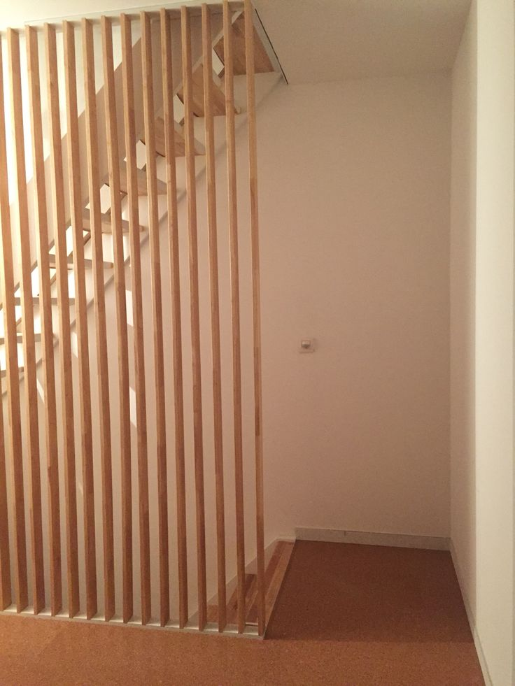 Rubberwood stair, wooden slats as bannister. Design by myself, execution by my dad.