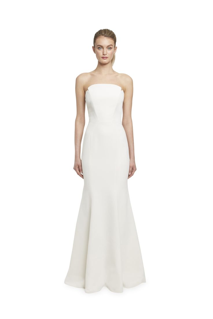 Jill Jill Stuart  A dramatic hourglass strapless gown with artfully sculpted neckline and seaming detail. Boning all around. Silicone gel elastic on inside top edge. Center back metal zipper with hook and eye on top.