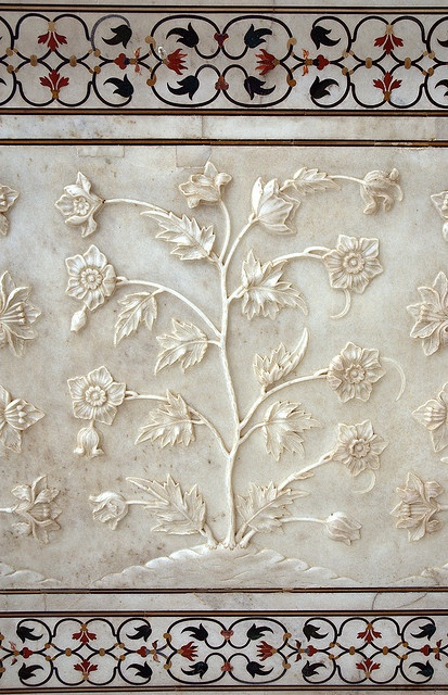 Marble flower detail carved out along the outside wall of the Taj Mahal.